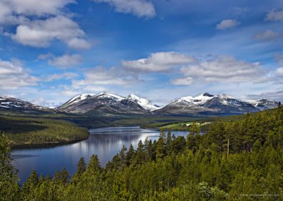 View of the Rondane peaks with lake Atna in the foreground